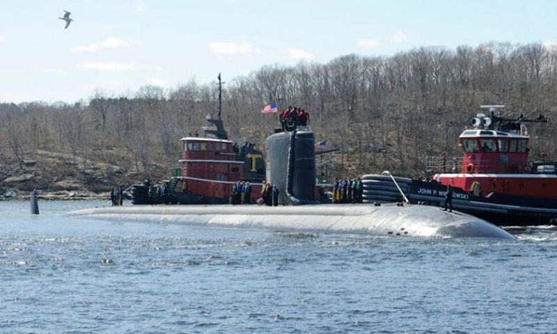 The USS Alexandria makes its way up the Thames River and home to Submarine Base New London in Groton, Conn., in April 2013. A machinist's mate has been accused of using his cellphone to take photos of sensitive electronic equipment aboard the fast-attack submarine, according to the Navy Times. (U.S. Department of Defense)