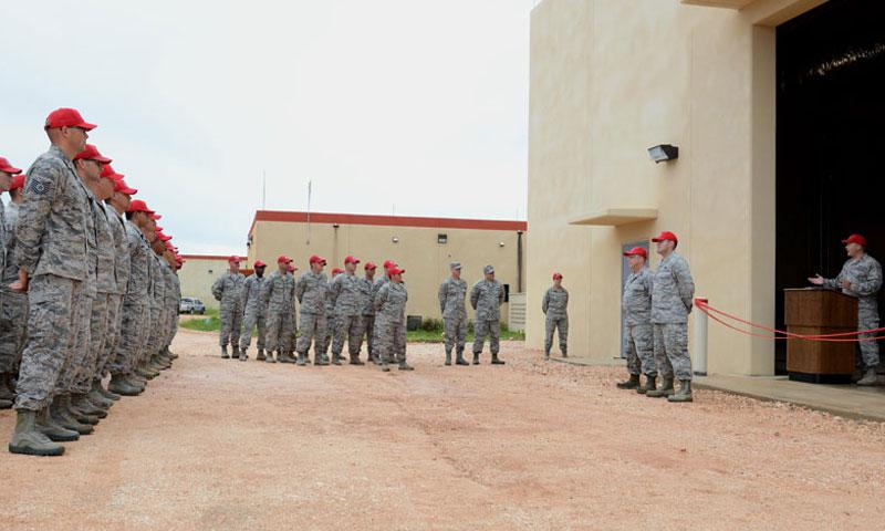 Airmen with the 556th, 554th and 254th RED HORSE Squadrons attend a ribbon cutting ceremony July 26, 2016, at Andersen Air Force Base, Guam. The five-month long project brought together Reservists from four RHS units consisting of nine rotations for hands-on training with the 556th RHS as the lead unit for the duration of the project. (U.S. Air Force photo/Airman 1st Class Arielle Vasquez)