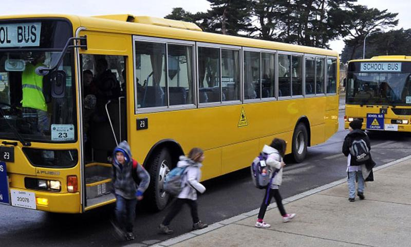 Students step off school buses at Sollars Elementary at Misawa Air Base, Japan, on March 21, 2011. (Beatrice Brown/U.S. Air Force)