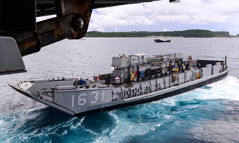 APRA HARBOR, Guam (Aug. 7, 2015) Landing Craft Utility 1631, assigned to Naval Beach Unit (NBU) 7, disembarks the well deck of the amphibious transport dock ship USS Green Bay (LPD 20) as the ship approaches Guam. Green Bay is assigned to the Bonhomme Richard Expeditionary Strike Group and is on patrol in the U.S. 7th Fleet area of operations (U.S. Navy photo by Mass Communication Specialist 3rd Class Derek A. Harkins/Released)