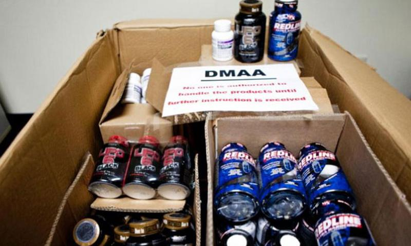 Bottles of dietary supplements containing dimethylamylamine, or DMAA, sit in boxes in the Yokota exchange store room. The Army and Air Force Exchange Service pulled the supplements from the shelves as the Defense Department investigates a possible link between DMAA and the deaths of two soldiers. (Photo by Grant Okubo/Stars and Stripes)