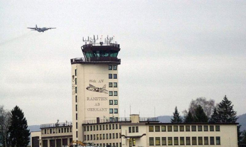 A C-130 aircraft flies over a tower at Ramstein Air Base, Germany, on Dec. 17, 2002. Six of the nine U.S. servicemembers wounded during an insider attack -- which killed Maj. Gen. Harold J. Greene on Tuesday, Aug. 5, 2014, in Afghanistan -- were flown to Ramstein and transferred to Landstuhl Regional Medical Center where they are listed in stable condition. (David D. Underwood/U.S. Air Force)