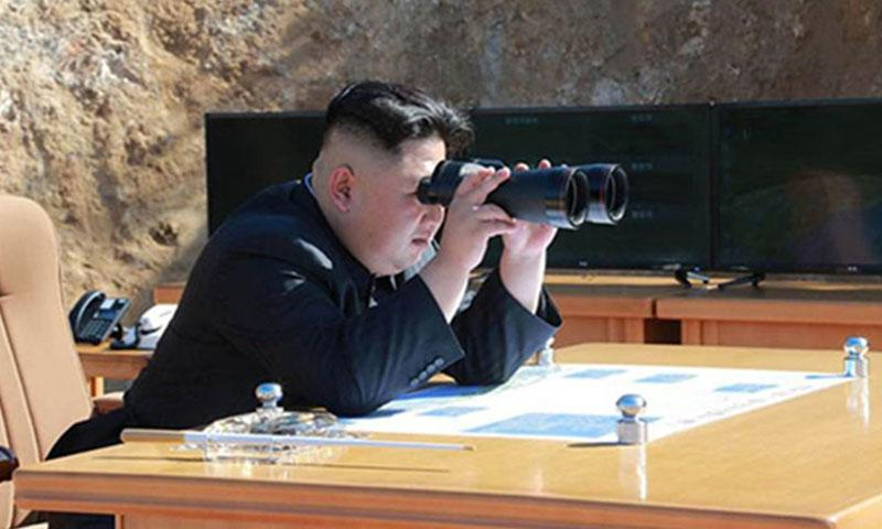 North Korean leader Kim Jong Un watches what North Korea claims was its first successful test of an intercontinental ballistic missile on July 4, 2017. (COURTESY OF KCNA)