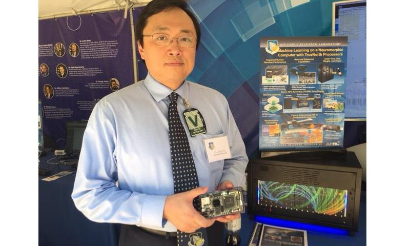 Qing Wu, an Air Force Research Laboratory principal electronics engineer, holds a TrueNorth computer chip at Department of Defense Lab Day, a biennial technology exhibit, at the Pentagon, May 18, 2017 (DoD photo by Rick Docksai)