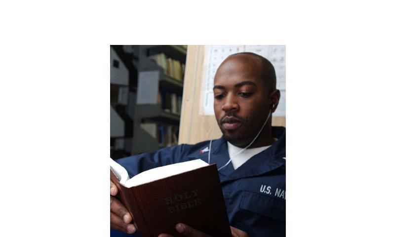 Petty Officer 3rd Class Matthew Smalls reads a bible in 2008. (U.S. Navy)