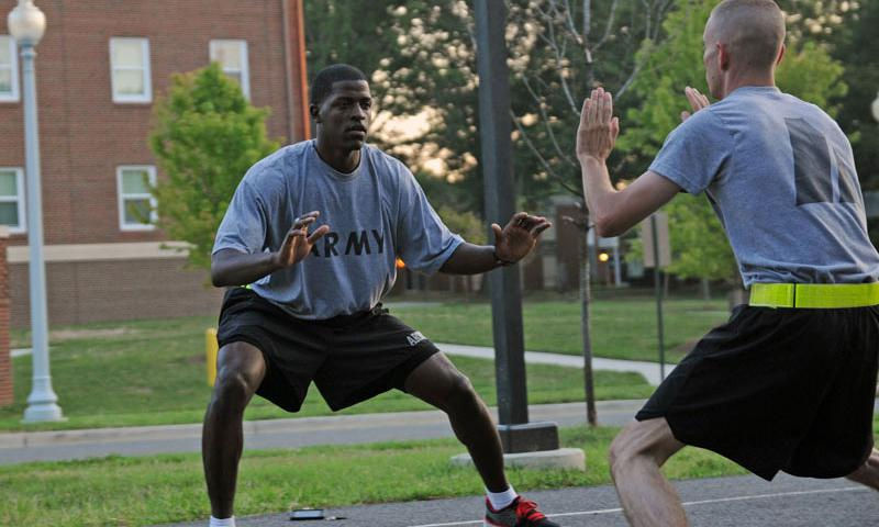 Staff Sgt. Terrell Moorer (left), 529th Regimental Support Company, 3d U.S. Infantry Regiment (The Old Guard), leads Staff Sgt. Patrick Hallin a shuffle drill during physical fitness training Aug. 16 at Joint Base Myer-Henderson Hall, Va. Moorer, a two-season All-Army Basketball player, uses the shuffle drill to help soldiers work on their agility. U.S. Army photo by Staff Sgt. Megan Garcia