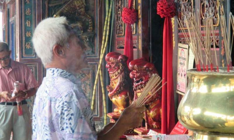 A man waves incense at the Cheng Hoon Teng Temple in Melaka. In addition to this Chinese temple, built in the 1600s, the city has churches and a mosque, reflecting its multcultural heritage. (Photo by Ashley Rowland/Stars and Stripes)