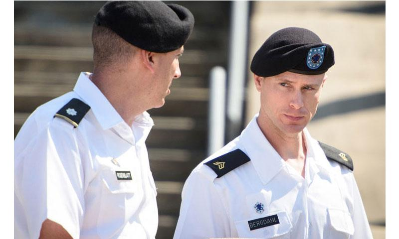 Sgt. Bowe Bergdahl, right, talks with his military attorney, Lt. Col. Franklin Rosenblatt after, after a hearing, Wednesday, Aug. 24, 2016, on Fort Bragg, N.C. (Andrew Craft/The Fayetteville Observer via AP)