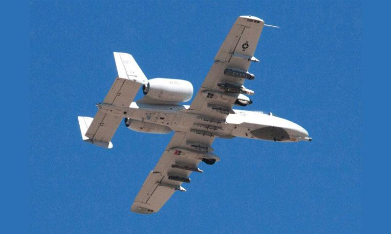 "An A-10 ""Warthog"" flies over Davis-Monthan Air Force Base, Ariz., in October, 2015. (Joe Gromelski/Stars and Stripes)"