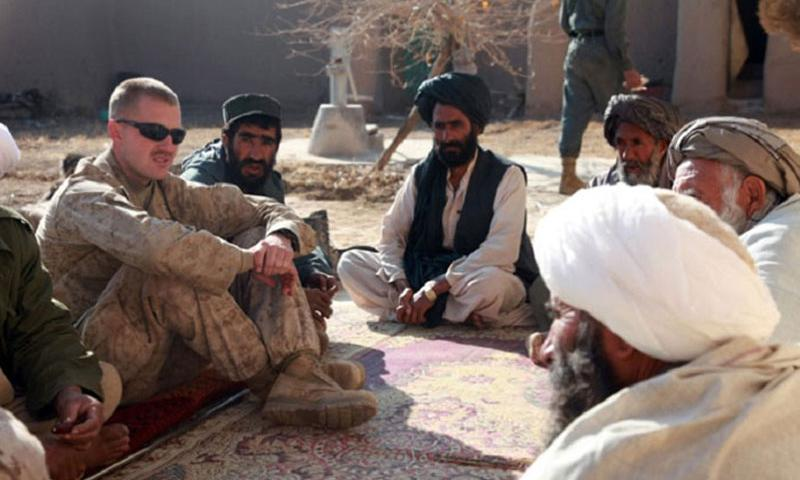 In this 2009 file photo, former Marine Corps Capt. Jason C. Brezler meets with Afghan leaders in Now Zad, Afghanistan. Brezler was ordered by Lt. Gen. Richard P. Mills to appear before an administrative board that met in December 2013 and recommended he be discharged for alleged mishandling of classified information. The Defense Department Inspector General's office is investigating, according an Aug. 19 IG memo sent to Brezler. (Albert F. Hunt/U.S. Marine Corps)