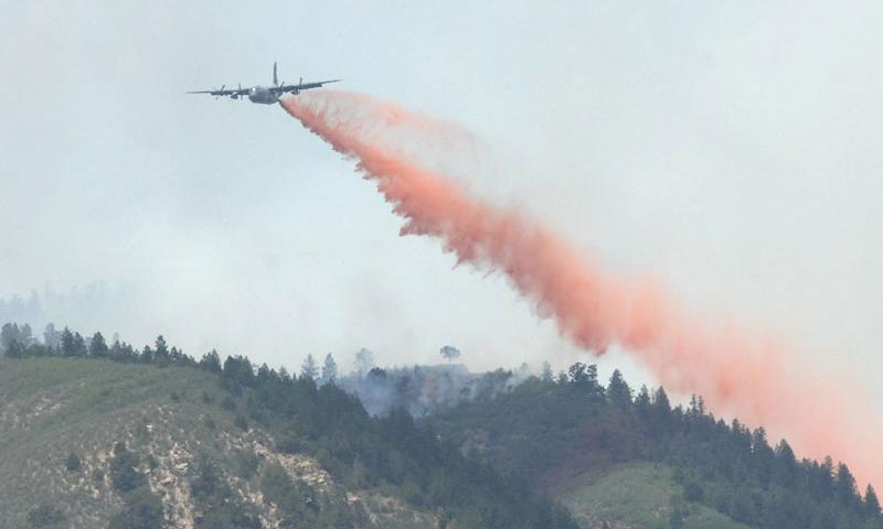 A Modular Airborne Fire Fighting System-equipped C-130 drops retardant on a section of the Waldo Canyon fire near Colorado Springs, Colo., June 26, 2012. Air Force Reserve and Air National Guard MAFFS-equipped C-130s have exceeded 2 million gallons of fire retardant dropped during the 2012 wildfire season. U.S. Air Force photo by Tech. Sgt. Thomas J. Doscher