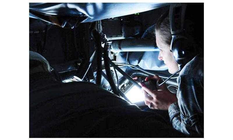 Experience of a Lifetime: Airman 1st Class Melinda Arquette, 36th Medical Operations Squadron medical technician, takes photographs of the aerial refueling of a B-52 Stratofortress during an incentive flight on Andersen Air Force Base Aug. 10. The aerial refueling is one of the highlights of a KC-135 incentive flight. U.S. Air Force photo by Airman 1st Class Marianique Santos/Released