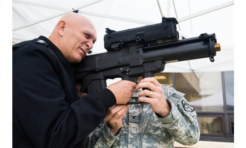 Then-Army Chief of Staff Gen. Ray Odierno looks through the sight of an XM25 Counter Defilade Target Engagement System during his visit to the Program Executive Office Soldier facility at Fort Belvoir, Va., on Nov 1, 2013. (Steve Cortez/U.S. Army)