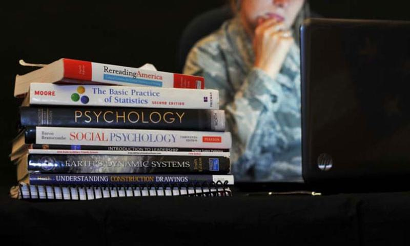 Military members wishing to continue their education can find that there are a variety of financial assistance programs to help fund their endeavors. (Photo by William Wiseman/U.S. Air Force)