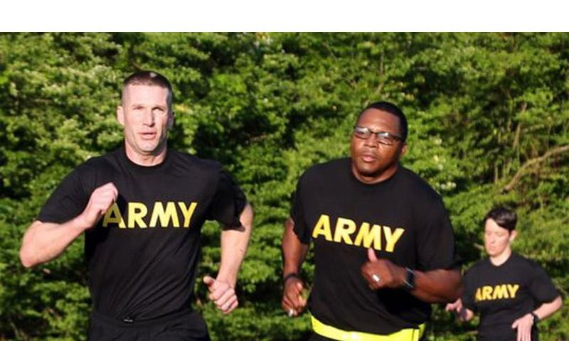 Sgt. Maj. of the Army Dan Dailey, left, conducts physical training with soldiers at Redstone Arsenal, Ala. in May 2015. (Michael Zuk/U.S. Army)