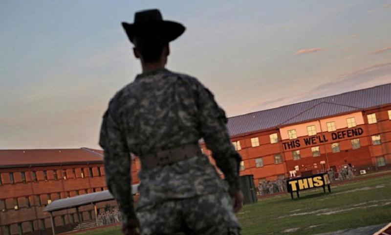 Drill Sergeant Leader Sgt. 1st Class Elizabeth Weaver prepares for another day of teaching candidates at the U.S. Army Drill Sergeant School at Fort Jackson in Columbia, S.C., on Aug. 22, 2014. The Army is celebrating the 50th anniversary of the U.S. Army Drill Sergeant Program. (Gerry Melendez, The State/MCT)