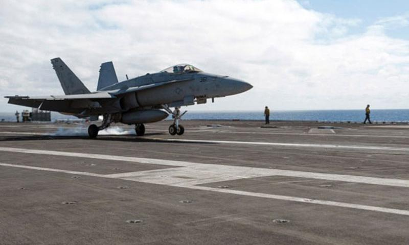 An F/A-18C Hornet lands on the flight deck of the USS Carl Vinson on April 2, 2014, while the aircraft carrier was underway off the coast of Southern California conducting unit-level training. The Navy reported that two Hornets from the Carl Vinson crashed Friday, Sept. 12, 2014, in the western Pacific. (Scott Fenaroli/U.S. Navy)