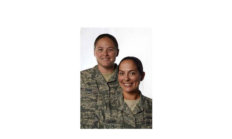 Tech. Sgt. Stacey Shunk, left, and Master Sgt. Angela Shunk are the first Air Force same-sex couple to be accepted for an assignment under the service's Join Spouse program. (Photo by Ryan Conroy/U.S. Air Force)