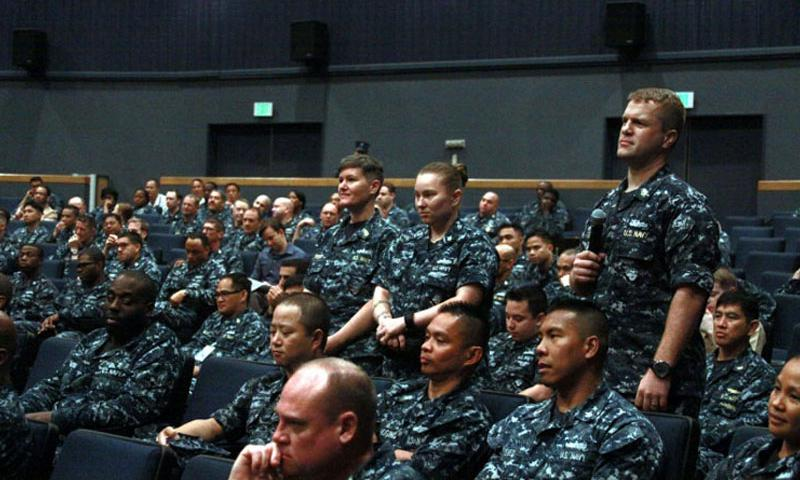 "Chief Petty Officer Jennifer Brett, standing on left, and Petty Officer 1st Class Rachel Thao wait to ask questions at an open forum with Master Chief Petty Officer of the Navy Michael Stevens at Yokosuka Naval Base, Japan, on June 22, 2015. Servicemembers like Brett and Thao, who both have active-duty husbands, must choose one parent to ""sponsor"" their children under regulations covering overseas service. (Tyler Hlavac/Stars and Stripes)"
