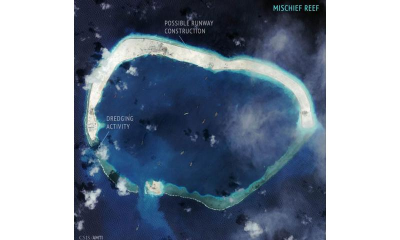 This Sept. 8, 2015, satellite image shows activity consistent with runway construction on Mischief Reef, which is near an oil and gas field claimed by the Philippines. (Courtesy of the Asia Maritime Tr)