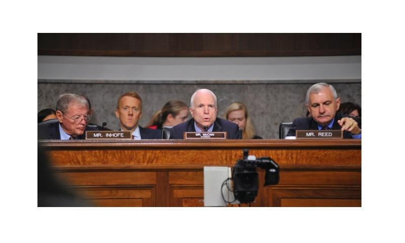 "Chairman of the Senate Armed Services Committee Sen. John McCain, R-Ariz., speaks during a hearing on Capitol Hill on Thursday, Sept. 15, 2016. Ranking Member Sen. Jack Reed, D-R.I., at right, said money remains a ""significant issue"" as lawmakers in Congress indicated Friday that they will not finish an annual defense budget bill by the end of the month. (Carlos Bongioanni/Stars and Stripes)"