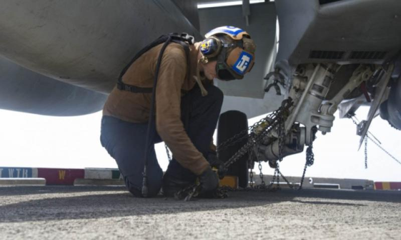 Petty Officer 3rd Class Kyle Hargis, an Aviation Machinist's Mate, secures an F/A-18F Super Hornet assigned to the Fighting Swordsmen of Strike Fighter Squadron 32 to the flight deck of the aircraft carrier USS Dwight D. Eisenhower July 18, 2016.Such tasks are among those performed by plane captains, junior sailors trained to ensure aircraft are in top shape and mission-ready. (Dartez C. Williams/U.S. Navy)