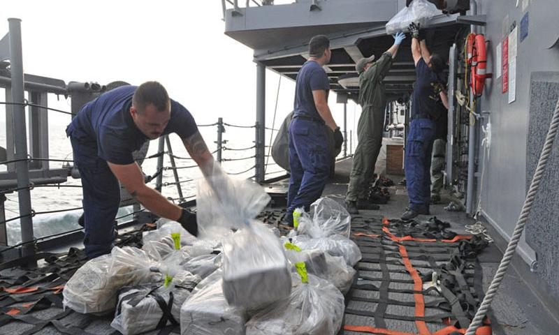 Personnel from the U.S. Coast Guard Law Enforcement detachment embarked aboard the guided-missile frigate USS Rentz (FFG 46) prepare an estimated $78 million of confiscated cocaine for transfer to the U.S Coast Guard cutter USCGC Forward (WMEC 911) from a drug bust made on Aug 16 during Operation Martillo counter transnational organized crime operations while assigned to U.S. 4th Fleet. (U.S. Navy photo by Lt. Cmdr. Corey Barker/Released)