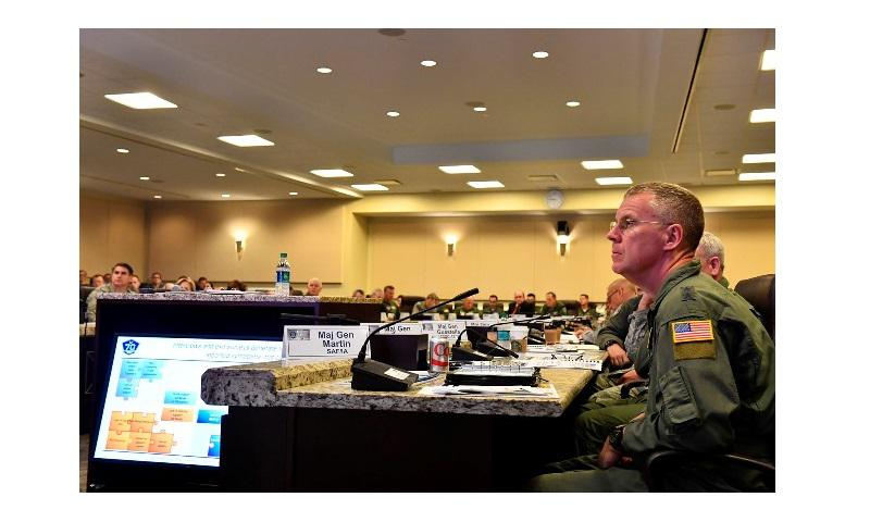 Maj. Gen. Lawrence Martin, assistant deputy under Secretary of the Air Force for Internal Affairs, listens as Capt. Michael Byrnes, Chief of Staff doctoral scholar, briefs attendees about pilot retention at the annual Air Crew Summit at Joint Base Andrews, Md., Sept. 22, 2017. (U.S. Air Force photo by Scott M. Ash)