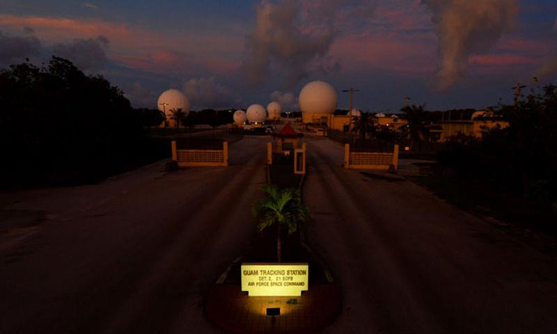 The sun sets on the 21st Space Operations Squadron Detachment 2 tracking station Sept. 15, 2015, at Northwest Field on Andersen Air Force Base, Guam. The 21st SOPS Det 2 celebrated its 50th anniversary with a ceremony here Sept. 17. (U.S. Air Force photo by Airman 1st Class Alexa Ann Henderson/Released)