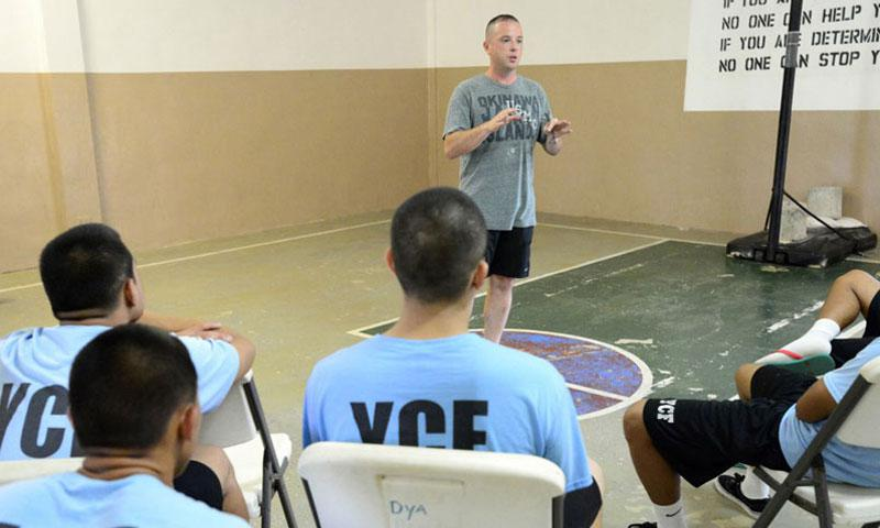 Capt. Robert Hatchley from Marine Aircraft Group 12 talks to incarcerated youth at a Youth Correctional Facility located in Barrigada. (Photo by Mass Communication Specialist 1st Class John Johnson, U.S. Navy)