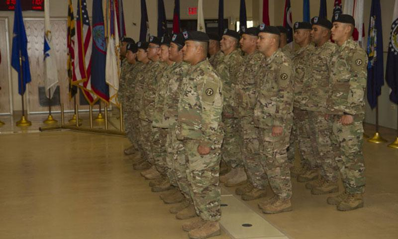 BARRIGADA, Guam – Soldiers with Detachment 5, 368th Military Police, 9th Mission Support Command, sing the Army Song to conclude their deployment ceremony at the Guard Army National Guard Assembly Hall on Saturday, Sept. 24. (Photo By Staff Sgt. James Kennedy Benjamin)
