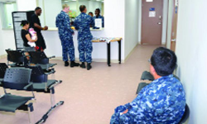 Patrons wait at the customer service window at the new U.S. Naval Base Guam (NBG) Personnel Support Detachment (PSD) office Aug. 31. PSD is now located in building 3191 along with NBG Housing and Personal Property Office. U.S. Navy photo by Mass Communication Specialist 2nd Class Jeremy Star