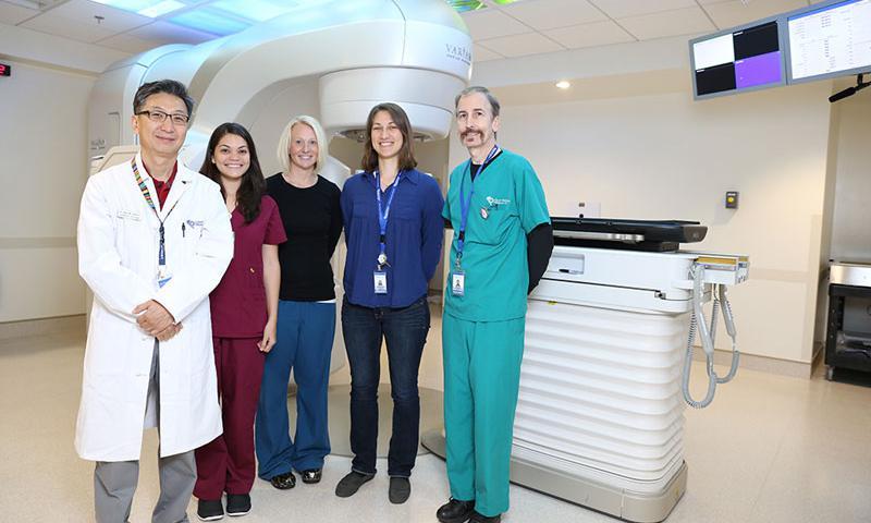 Pictured from left are Radiation Oncologist Arthur Ko, RN Summer Medler, RT Manager Katie Kessler (R) (T), Medical Physicist Amanda Jackson (MS) (DABR) , Medical Dosimetrist Mark Craft.