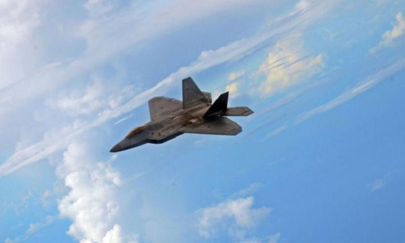 An F-22 Raptor flies at an altitude of about 21,000 feet during the Valiant Shield exercise Sept. 19, 2014, north of Guam. Valiant Shield includes an emphasis on the Air Sea Battle concept, a set of tactics that analysts say is aimed at deterring China from destabilizing the Asia-Pacific region. (Erik Slavin/Stars and Stripes)