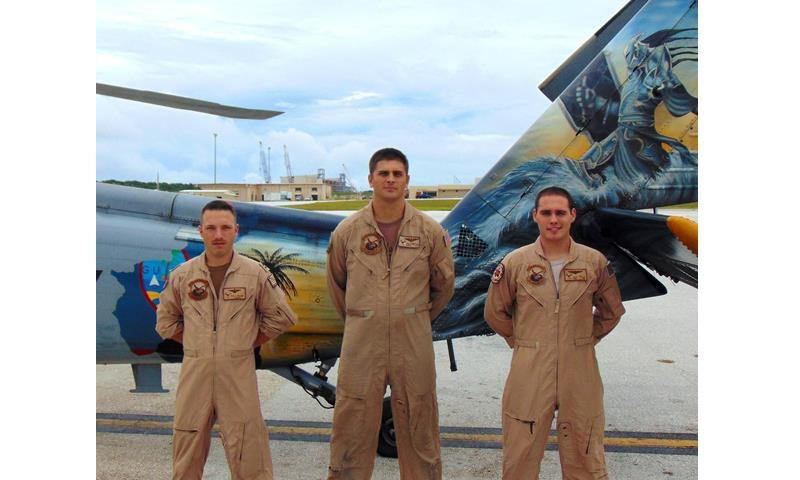 From left to right, Lt. Walter McGann, Naval Aircrewman First Class Johnathan Hampton, Naval Corpsman Third Class Jacob Tittle, (not pictured) AWS2 Ryan Duran-fujii and Lt. William B. Thornley, Helicopter Sea Combat Squadron Two-Five search and rescue crew members stand in front of a MH-60S Seahawk at Andersen Air Force Base, Guam. (Courtesy photo)