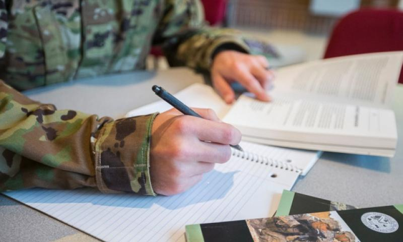 A military photo illustration depicts a servicemember studying. (Nell King/Defense Department)