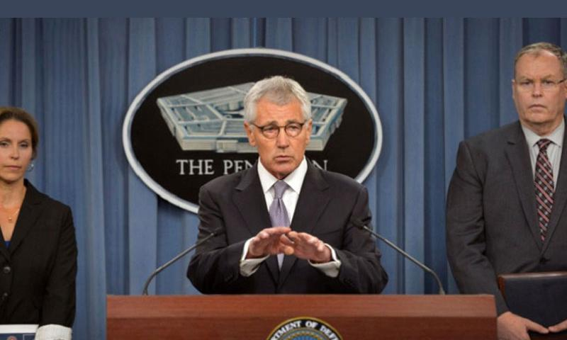 Secretary of Defense Chuck Hagel and Deputy Secretary of Defense Bob Work, right, brief the press on the Military Health System, October 1, 2014. (Glenn Fawcett/Department of Defense)