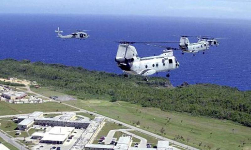 Two UH-46 Sea Knights and two MH-60 Knight Hawks fly over Andersen Air Force Base, Guam, in this file photo. (Joshua P. Strang/U.S. Air Force)