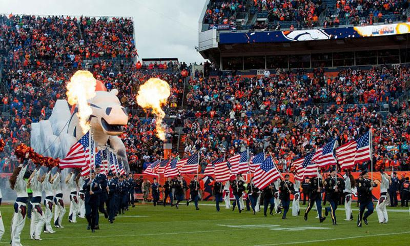"U.S. soldiers and airmen with the Colorado National Guard participate in the ""Salute to Service"" pre-game events at Sports Authority Field at Mile High, just before the Denver Broncos host the Miami Dolphins in Denver, Colo., Nov. 23, 2014. (Wolfram M. Stumpf/U.S. National Guard)"