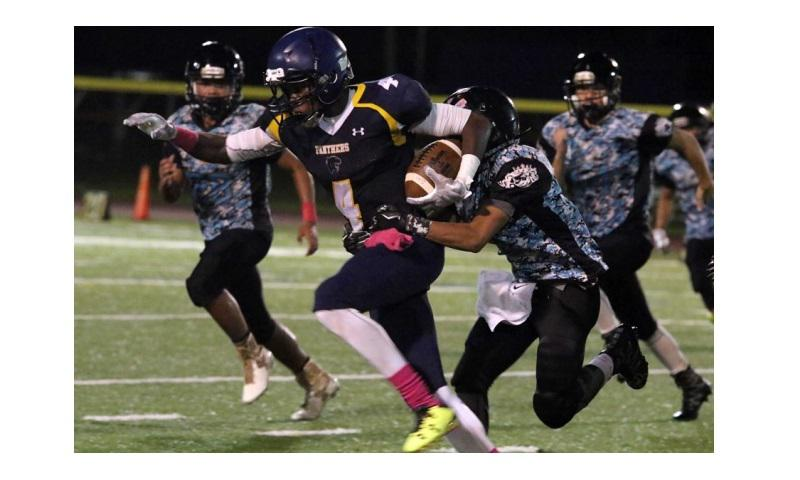Will Sanders of Guam High drags a Southern defender into the end zone for yardage (DONNA RHODES/SPECIAL TO STRIPES)