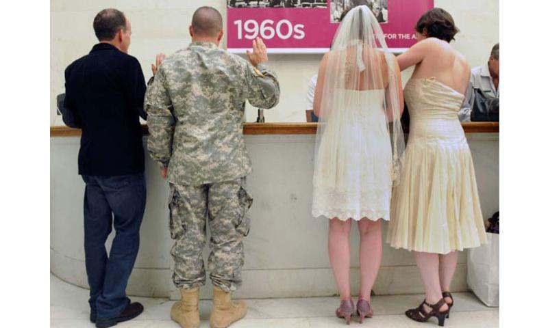 U.S. Army Sgt. Michael Potoczniak and his partner Todd Saunders go through the process of getting married at city hall in San Francisco, Calif., along with Cynthia Wides and Elizabeth Cary in June 2013. (Photo by Waly Skalij/Los Angeles Times/MCT)