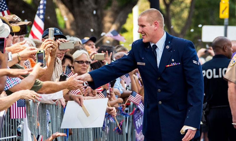 Airman 1st Class Spencer Stone greets the crowd during a parade in Sacramento, Calif., Sept. 11, 2015. Stone, one of three Americans who helped stop a terror attack on a Paris-bound train in August, was recuperating Thursday, Oct. 8, 2015, after having been repeatedly stabbed just after midnight in Sacramento. (Charles Rivezzo/U.S. Air Force)
