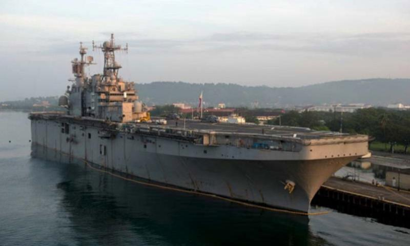 The amphibious assault ship USS Peleliu is seen moored at Subic Bay, Philippines, on Sept. 29, 2014, for Amphibious Landing Exercise (PHIBLEX) 2015. (Amanda R. Gray/U.S. Navy)