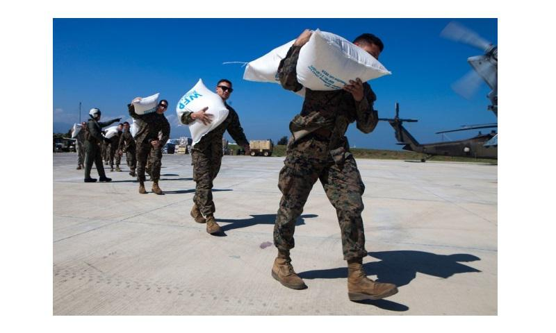 U.S. Marines and sailors load relief supplies onto helicopters at Port-au-Prince, Haiti on Oct. 13, 2016 (Adwin Esters/U.S. Marine Corps)
