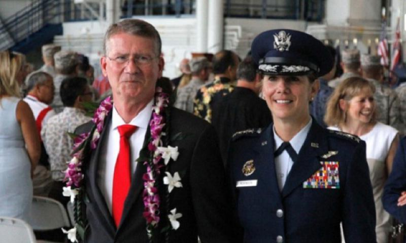 Air Force Gen. Lori Robinson departs the ceremony Thursday at which she became commander of U.S. Pacific Air Forces, marking the first time a woman has been appointed general of a joint forces air component command. To the left is her husband, David Robinson, a retired major general. (Wyatt Olson/Stars and Stipes)