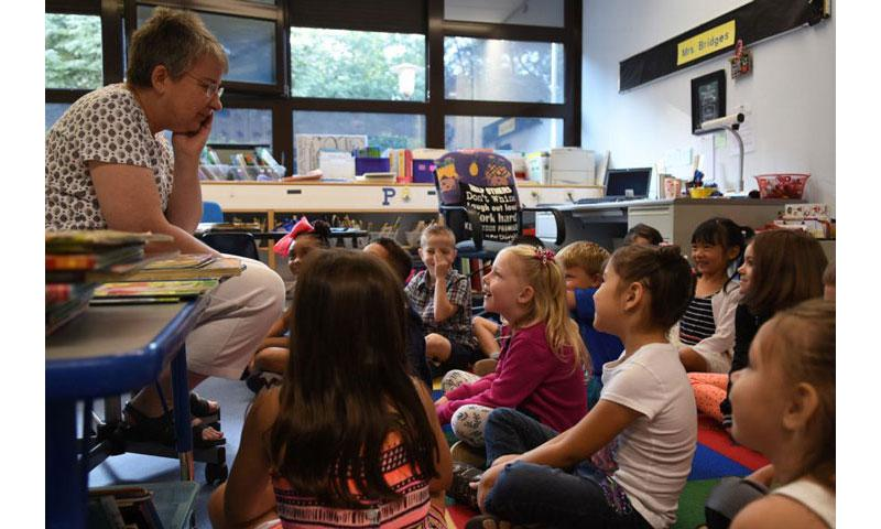 With her first-graders gathered around on the first day of school on Monday, Aug. 28, 2017, Ramstein Elementary School teacher Janet Bridges tries to remember names of all of her students. (JENNIFER SVAN/STARS AND STRIPES)