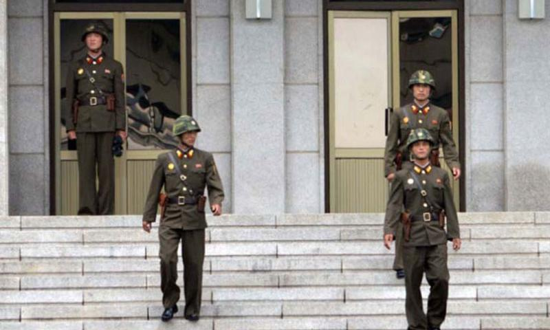 North Korean soldiers walk down the stairs of the Panmungak building at the Joint Security Area, North Korea, July 27, 2013. North Korean soldiers regularly venture out of the building to observe their South Korean counterparts. (Photo by Armando R. Limon/Stars and Stripes)