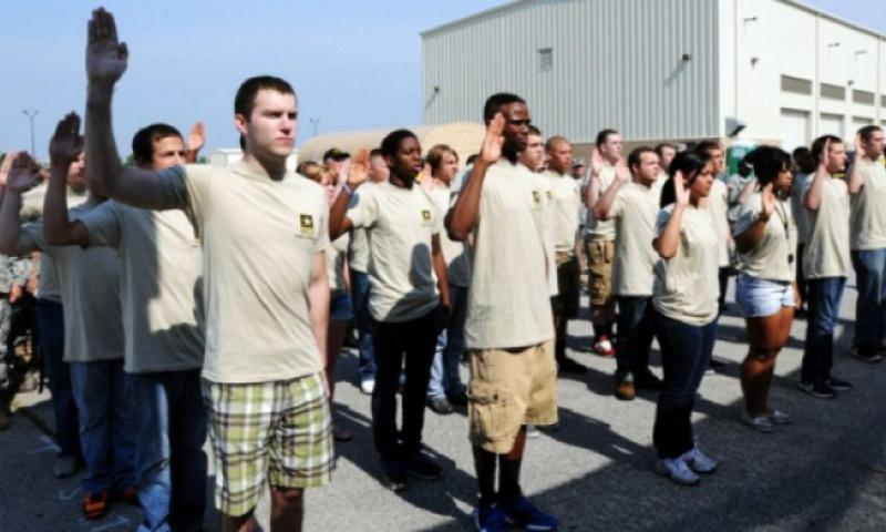 New recruits are sworn in during the Army Reserve Mega Event in Whitehall, Ohio, June 22, 2013. (Andrew Baba/U.S. Army)