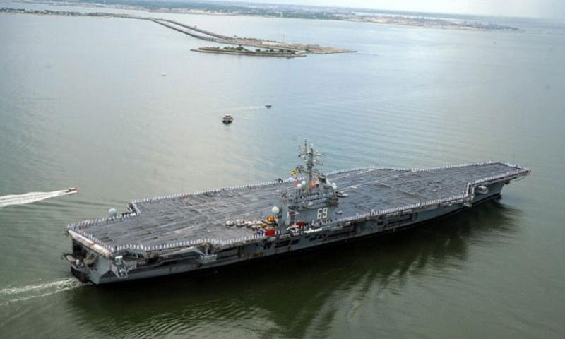 The aircraft carrier USS Dwight D. Eisenhower passes over the Hampton Roads Bridge Tunnel as the ship returns from deployment to Naval Station Norfolk, Va., in July 2013. The Navy announced in October, 2014, that after more than a year in the shipyard, the Eisenhower wouldn't be ready to return to the fleet and wouldn't deploy next fall, as planned. (Ryan D. McLearnon/U.S. Navy)