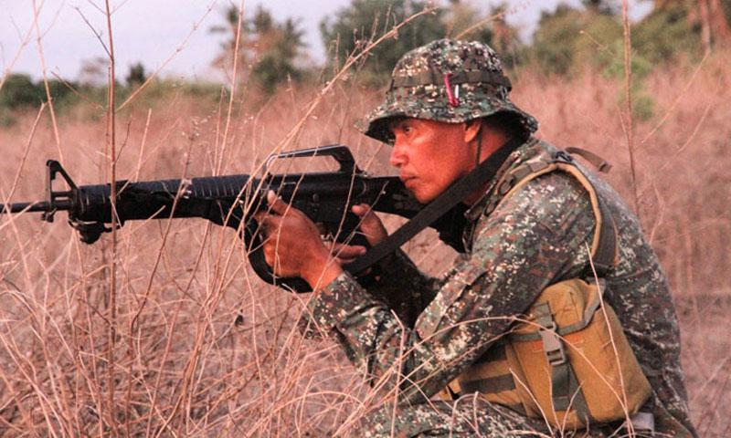 A Filipino marine guards the perimeter around the Antique airstrip in Panay, Philippines, during Balikatan April 11, 2016. (Wyatt Olson/Stars and Stripes)